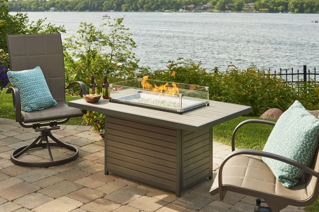 Modern composite wood look Brooks Rectangular Gas Fire Pit Table by The Outdoor GreatRoom Company for your backyard, patio, or lakeside space
