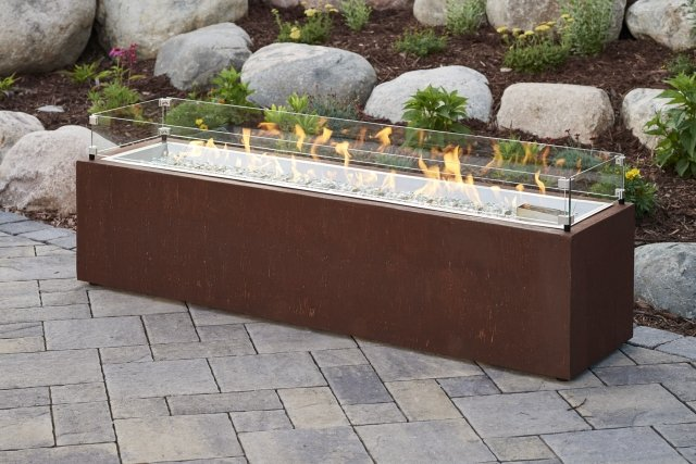 Trendy, modern style Cortlin Linear Gas Fire Pit Table with Glass Wind Guard by The Outdoor GreatRoom Company for your patio or deck