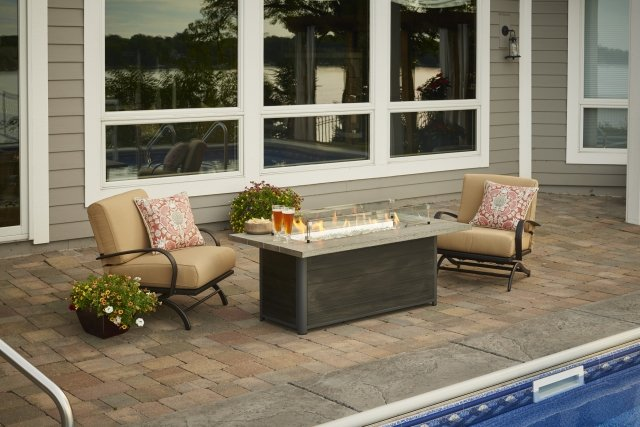 Stylish, industrial design Cedar Ridge Gas Fire Pit Table with Tan Chat Chairs by The Outdoor GreatRoom Company to complete your patio or deck