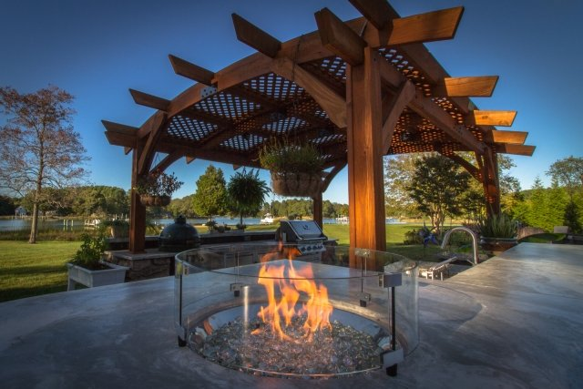 Custom Outdoor Kitchen with Wood Pergola and Gas Burner Design by The Outdoor GreatRoom Company for your patio, backyard, veranda, or deck
