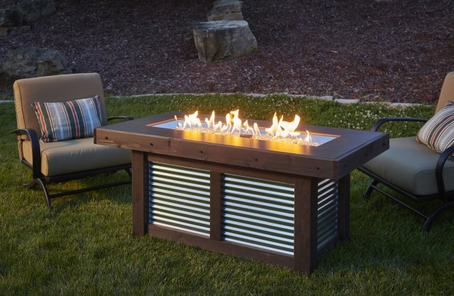 Rustic, corrugated Denali Brew Linear Gas Fire Pit Table by The Outdoor GreatRoom Company for your patio or backyard space