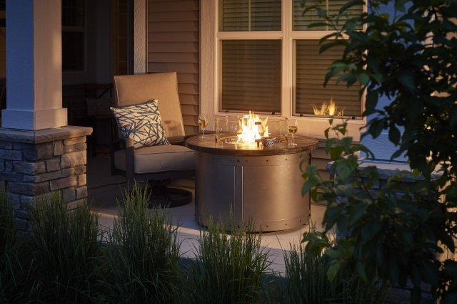 Industrial, modern style Edison Round Gas Fire Pit Table by The Outdoor GreatRoom Company for your unique porch or dream deck