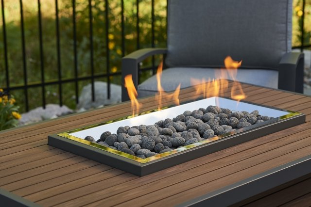 Versatile, Gas Fire-Approved Tumbled Lava Rock by the Outdoor GreatRoom Company for your patio or backyard fire pit table