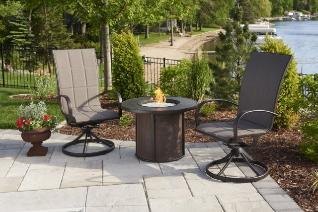 Versatile, simple style Stonefire Gas Fire Pit Table by The Outdoor GreatRoom Company for any patio or lakeside spot