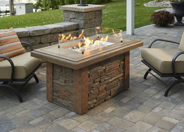 Faux stone, stylish design Sierra Linear Gas Fire Pit Table with Glass Wind Guard by The Outdoor GreatRoom Company for your patio or porch spot