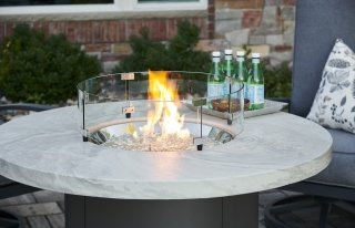 Modern, unique design White Onyx Beacon Dining Height Gas Fire Pit Table by The Outdoor GreatRoom Company for outdoor dining and entertaining