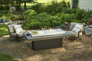 Upscale, coastal style Boardwalk Gas Fire Pit Table with Glass Guard by The Outdoor GreatRoom Company for your backyard or patio getaway