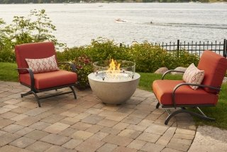 Stylish, contemporary look Cove 20 Gas Fire Pit Bowl with Papaya Chat Chairs by the Outdoor GreatRoom Company for your unique patio or backyard spot