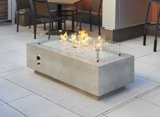 "Cove 54"" Linear Gas Fire Pit with flame and glass wind guard"
