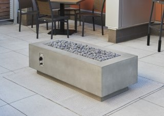 "Cove 54"" Linear Gas Fire Pit with optional tumbled lava rock for fire media"