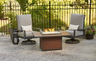 Modern, stylish design Kenwood Rectangular Chat Gas Fire Pit Table and Lyndale Swivel Rockers by The Outdoor GreatRoom Company for your patio or deck