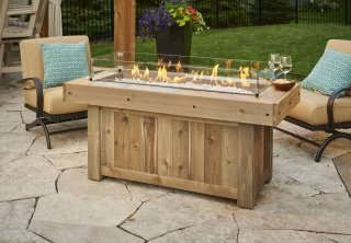 Faux wood and distressed cedar Vintage Linear Gas Fire Pit Table with Glass Wind Guard by The Outdoor GreatRoom Company for your backyard or patio spot